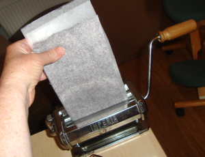 Repurposing and recycling an old pasta machine into a portable printing press